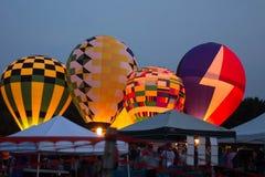 Hot air balloons at Ashland Balloonfest. Hot air balloons glowing during the Ashland Balloonfest, Ashland, Ohio on a warm summer evening royalty free stock images