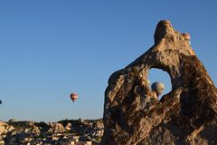 Hot air balloons behind rock with clear sky. In Goreme Cappadocia Royalty Free Stock Images