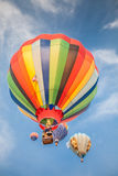 Hot-air balloons with blue sky and clouds background. Soft-focused hot-air balloons with blue sky and clouds background Stock Images