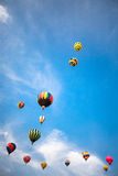 Hot-air balloons with blue sky and clouds background. Soft-focused hot-air balloons with blue sky and clouds background Stock Photography