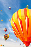 Hot-air balloons with blue sky and clouds background. Soft-focused hot-air balloons with blue sky and clouds background Royalty Free Stock Image