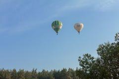 Hot air balloons Ceska Sporitelna and Bohemia-balon.cz over the forest. Bela pod Bezdezem, Czech Republic – June 24: Hot air balloons fly over the forest on Stock Photo