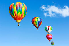 Hot air balloons. Colorful hot air balloons over blue sky stock photography
