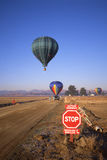 Hot Air Balloons Cross Runway Royalty Free Stock Photo
