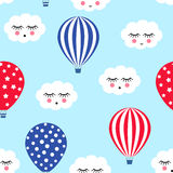 Hot air balloons with cute clouds seamless pattern. Bright colors hot air balloons design. Baby shower vector illustrations on blu Stock Image