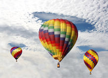 Hot Air Balloons Desending Thru the Clouds, Royalty Free Stock Photo