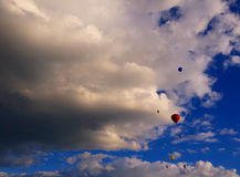 Hot air balloons and dramatic clouds background. Hot air balloons in dramatic cloud background stock photo
