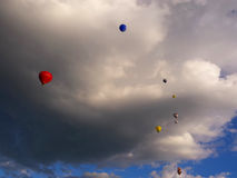 Hot air balloons and dramatic clouds background. Hot air balloons in dramatic cloud background royalty free stock image