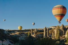 Hot air balloons festival in Goreme national park, fairy chimneys,. Cappadocia, Turkey stock photo