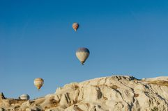 Hot air balloons festival in Goreme national park, fairy chimneys,. Cappadocia, Turkey royalty free stock image