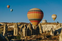 Hot air balloons festival in Goreme national park, fairy chimneys,. Cappadocia, Turkey stock photography