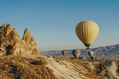 Hot air balloons festival in Goreme national park, fairy chimneys,. Cappadocia, Turkey royalty free stock image