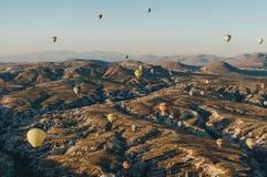 Hot air balloons festival in Goreme national park, fairy chimneys,. Cappadocia, Turkey royalty free stock photos