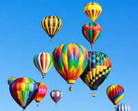 Hot air balloons fiesta. Colorful hot air balloons against blue sky royalty free stock images