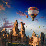 Hot air balloons flies in sunrise sky in Cappadocia, Turkey Stock Photos