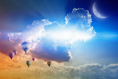 Hot air balloons flies in sunset sky Stock Photo