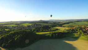Hot air balloons flight over beautiful landscape stock footage