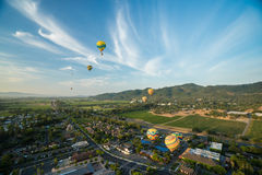 Hot Air Balloons Floating Above Vineyards Stock Photography
