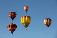 Hot Air Balloons Floating Against a Blue Sky Royalty Free Stock Photo