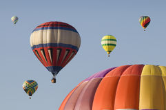 Hot-air Balloons Floating in a Blue Sky Royalty Free Stock Photos