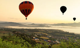 Hot air balloons floating over yun lai viewpoint, pai, thailand Stock Photo