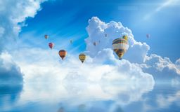 Hot air balloons fly in blue sky Stock Photo