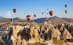 Hot air balloons fly in clear morning sky near Goreme, Kapadokya Royalty Free Stock Photography