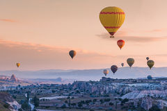 Hot air balloons fly over Cappadocia Royalty Free Stock Photo