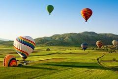 Hot air balloons fly over Cappadocia, Goreme, Cappadocia, Turkey. Royalty Free Stock Image