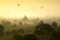 Hot air balloons fly over the pagoda ancient city field on silhouette sunrise scene at Bagan Myanmar Royalty Free Stock Photo