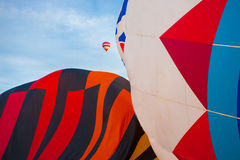 Hot-air balloons flying on a blue sky Royalty Free Stock Photography