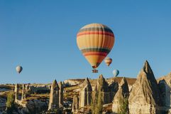 Hot air balloons flying in Goreme national park, fairy chimneys, Cappadocia, Turkey royalty free stock image