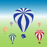 Hot air balloons flying with house Stock Photo