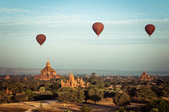 Hot air balloons flying over Buddhist Temples at Bagan. Myanmar Royalty Free Stock Photography