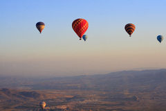 Hot air balloons flying over Cappadocia, Nevsehir, Turkey Stock Photos