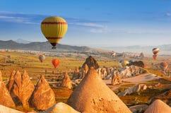 Hot air balloons flying over Cappadocia, Turkey Stock Photos