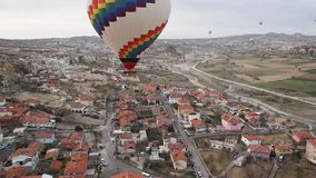 Hot Air Balloons flying over a city Royalty Free Stock Photography