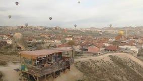 Hot Air Balloons flying over a city Stock Photos