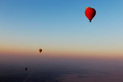 Hot air balloons flying over the desert Royalty Free Stock Image