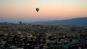 Hot air balloons flying over Goreme at sunrise. Cappadocia. Turkey stock video footage