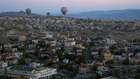 Hot air balloons flying over Goreme at sunrise. Cappadocia. Turkey stock footage