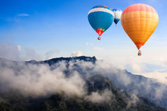 Hot-air balloons flying over the mountain Royalty Free Stock Photos