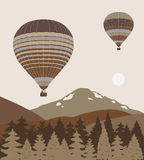 Hot air balloons over the mountains. Hot air balloons flying over the mountains Stock Photos