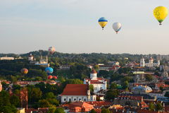 Hot air balloons flying over the old town. Vilnius. Lithuania Royalty Free Stock Photo