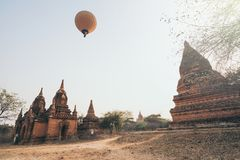 Hot air balloons flying over pagodas at Bagan temple complex, Myanmar