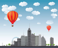 Hot air balloons flying over the town.Vector Stock Photography
