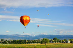 Hot air balloons flying over tranquil landscape Royalty Free Stock Photo