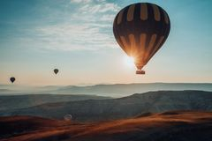 Hot air balloons flying over the valley at Cappadocia. Stock Photo