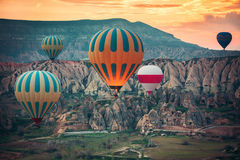 Hot air balloons flying over the valley at Cappadocia. Royalty Free Stock Image