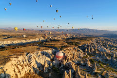 Hot air balloons flying over valley in the morning. Cappadocia. Turkey